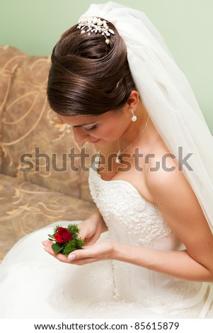 Portrait of beautiful young bride with wedding hairstyle