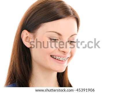Portrait of beautiful young brunette with brackets on teeth