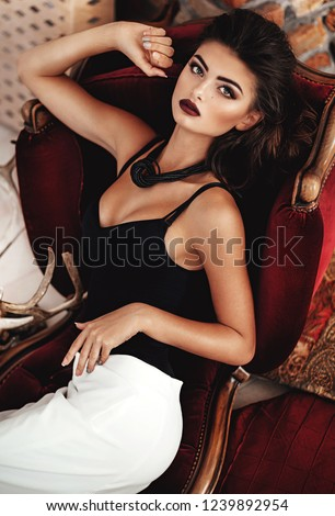 Portrait of beautiful young brunette woman with makeup  in fashion clothes #1239892954