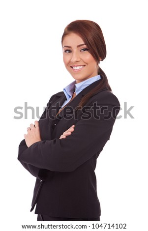 Portrait of beautiful young business woman smiling, standing with arms crossed over white background