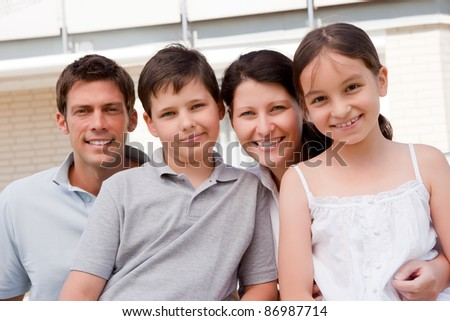 Portrait of beautiful young family together - Outdoor