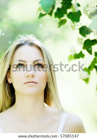 Portrait of beautiful young girl in summer park