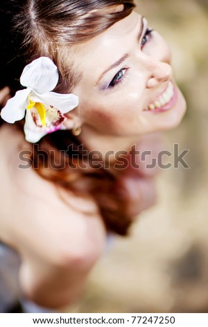 Portrait of beautiful young girl outdoors