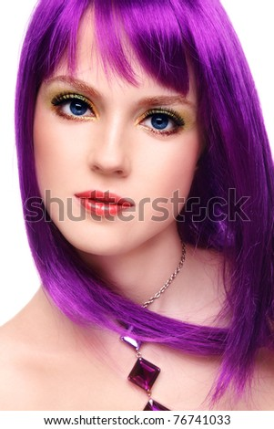 Portrait of beautiful young girl with fancy bright make-up and violet wig, on white background