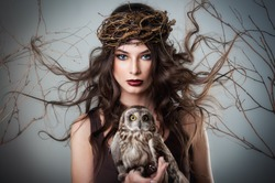 Portrait of beautiful young girl with owl