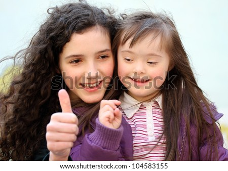 Portrait of beautiful young girls on the playground .