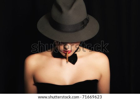 Portrait of beautiful young lady with hat! Isolated on black background! - stock photo