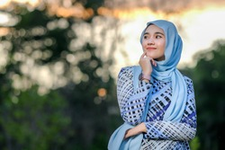 Portrait of beautiful young model  in fashionable hijab style posing in beautiful sunset . Stylish Muslim female hijab fashion lifestyle portraiture concept.
