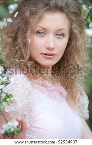 portrait of beautiful young model in pink dress