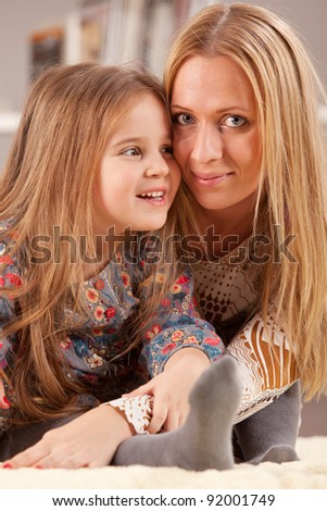 portrait of beautiful young mother with her little daughter