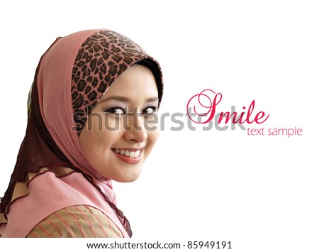 portrait of beautiful young Muslim woman was glanced into the camera with sweet smile on a white background
