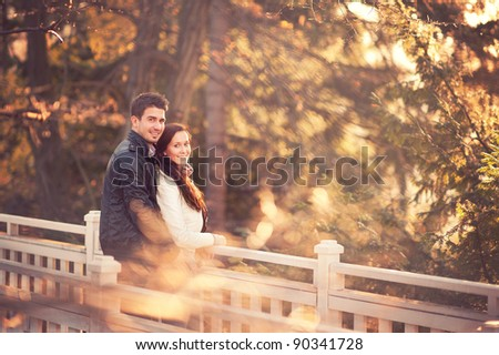 portrait of beautiful young pair in a park