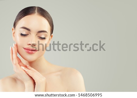 Portrait of Beautiful young perfect woman with clear skin. Skincare and facial treatment  #1468506995