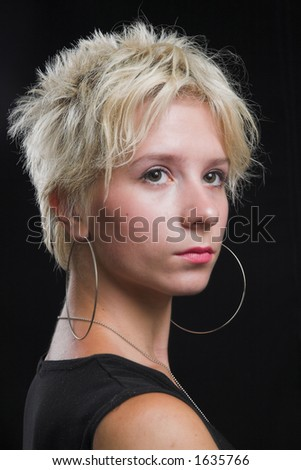 Portrait of beautiful young sexy woman on black background - head shot