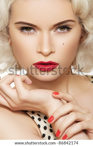 Portrait of beautiful young sexy woman with vintage make-up and hairstyle. Pin-up girl. American style