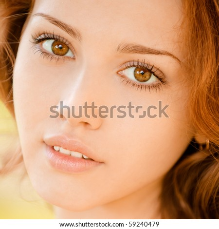 Portrait of beautiful young woman close up.