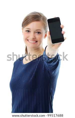 Portrait of beautiful young woman displaying mobile phone on white background - stock photo