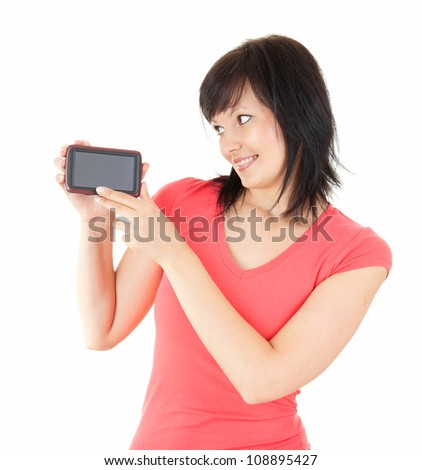 portrait of beautiful young woman holding smartphone, white background