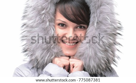 portrait of beautiful young woman in a jacket with a hood. #775087381