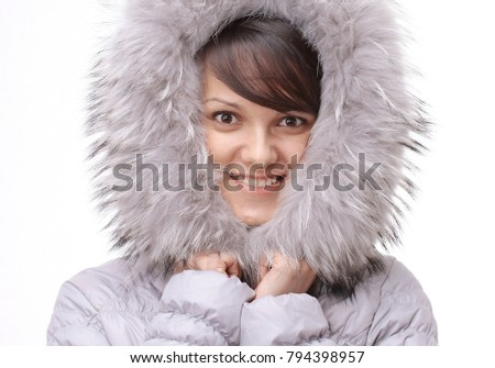 portrait of beautiful young woman in a jacket with a hood. #794398957