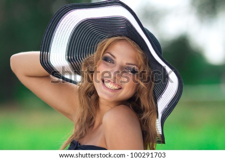 portrait of beautiful young woman in countryside