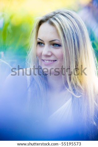 Portrait of beautiful young woman in summer garden