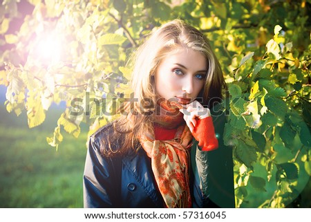 Portrait of beautiful young woman in sunset shine