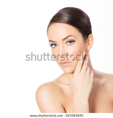 Portrait of beautiful young woman looking at camera, isolated on white #365084840