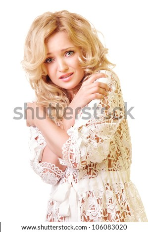 Portrait of beautiful young woman looking scared on white background