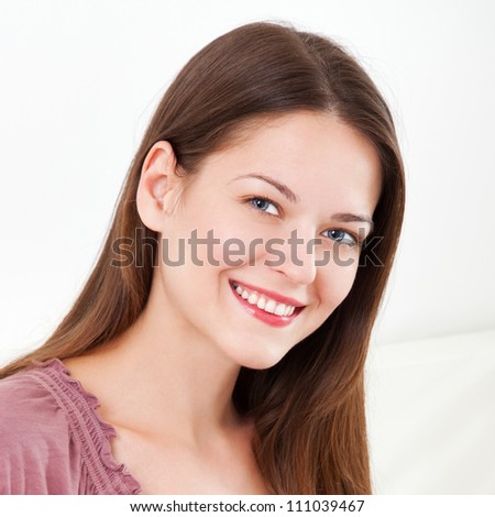 Portrait of beautiful young woman, on white background