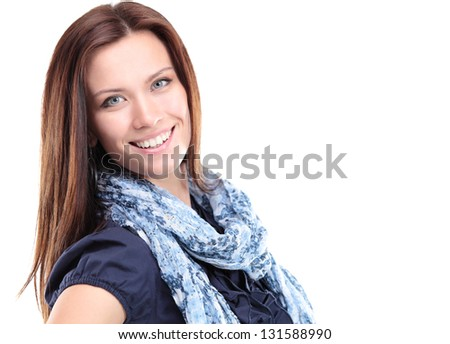 Portrait of beautiful young woman posing against white background