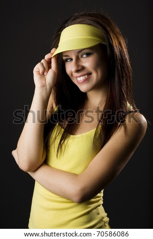Portrait of beautiful young woman posing on dark background