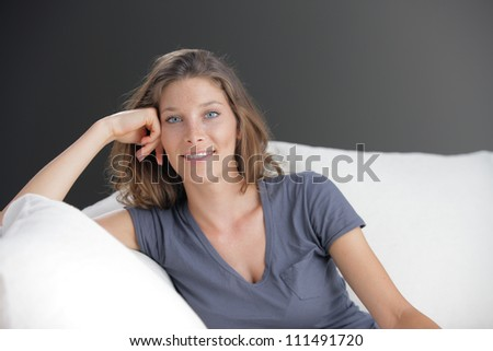 Portrait of beautiful young woman relaxing on couch