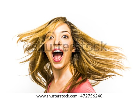 Portrait of Beautiful Young Woman Shaking Her Hair And  Screaming Over White Background #472756240