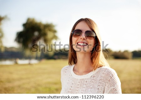Portrait of beautiful young woman smiling outdoors.