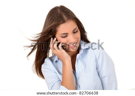 Portrait of beautiful young woman talking on mobilephone