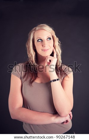 portrait of beautiful young woman thinking