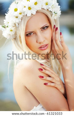 Portrait of beautiful young woman wearing floral wreath