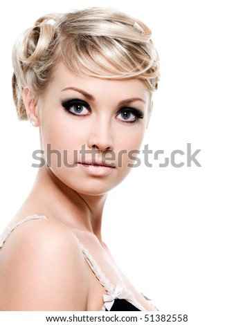 Portrait of beautiful young woman with blond hair -  isolated on white