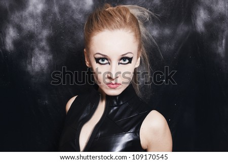 Portrait of beautiful young woman with bright gothic makeup closeup