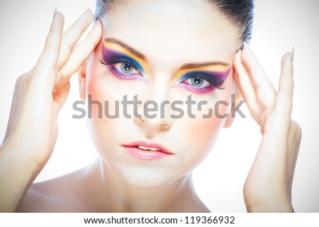 Portrait of beautiful young woman with bright make-up - stock photo