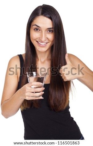 Portrait of beautiful young woman with glass of water...