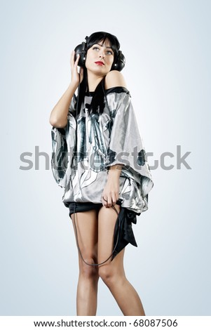 Portrait of beautiful young woman with headphones.