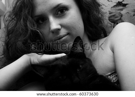 Portrait of beautiful young woman with her cat