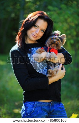 Portrait of beautiful young woman with her yorkshire terrier