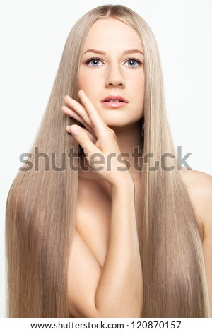 Portrait of beautiful young woman with long blond hair