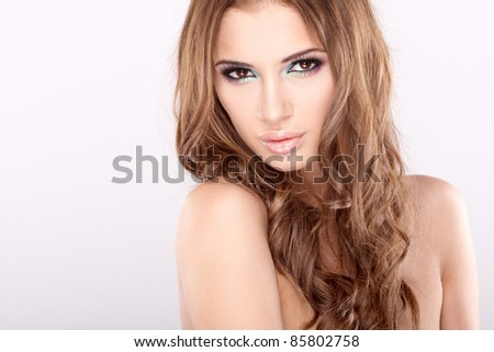 portrait of beautiful young woman with long brown hair posing isolated on white background