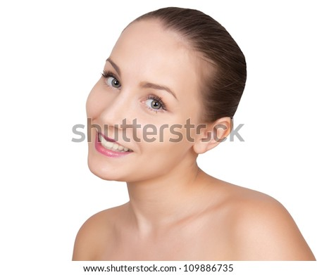 Portrait of beautiful young woman with perfect clean, healthy skin and bare shoulders. Caucasian girl with nice smiling face isolated on white background