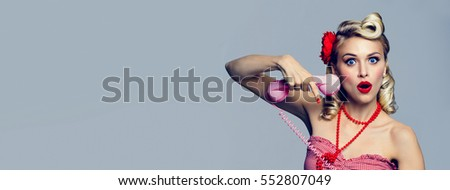 Portrait of beautiful young woman with phone, dressed in pin-up style. Caucasian blond model posing in retro fashion and vintage concept studio shoot. Horizontal banner composition. #552807049