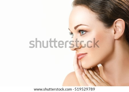 Portrait of beautiful young woman with pretty face.Pretty girl with big eyes and dark eyebrows, with naked shoulders.